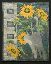 Quilt block of a Russian Blue (gray) cat, nuzzling a bunch of sunflowers