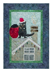 Quilt block of a Tasmanian Devil dressed as Santa on a roof with a sack of coal.