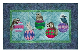 Quilt block of Christmas baubles with Australian animals hanging off of them, including a bilby, a tawny frogmouth, a kookaburra, and two sugar gliders.