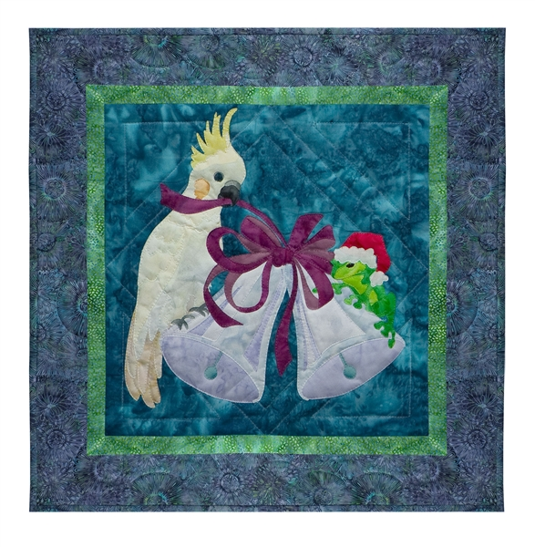 Quilt block of a cockatiel and a frog ringing in the season with a pair of bells.