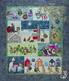Quilt showing the bright colors of a Down Under Christmas, complete with Santa, surfing, and silly animals.