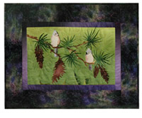 Quilt block of a titmouse being serenaded by her paramour, on the branch of a pine tree.