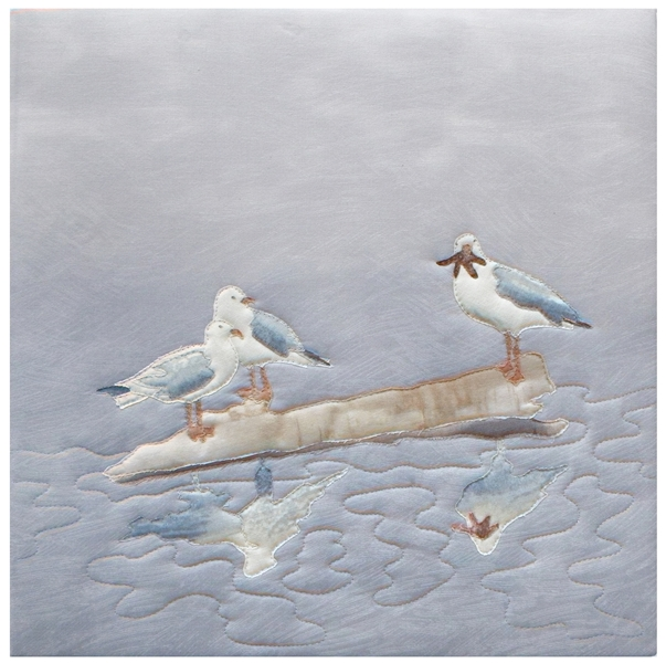 Quilt block of two seagulls on a log in the water, looking appraisingly at a third seagull, who has dinner...for now.
