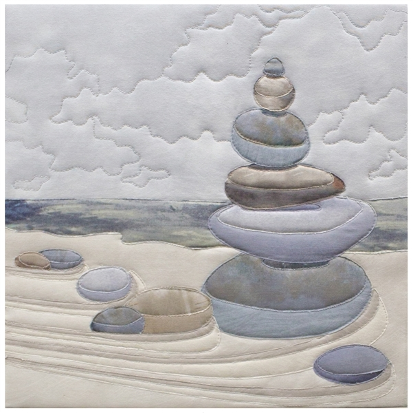Quilt block of the art of clearing your mind and stacking beach rocks.
