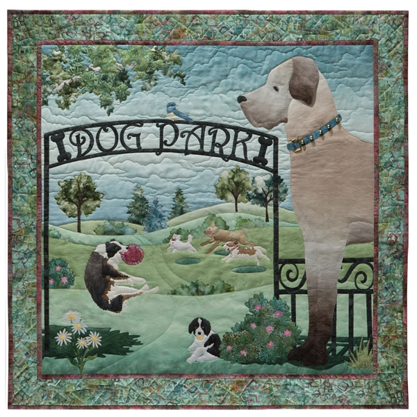 Quilt block of the entrance to the dog park, with a gate, flowers, trees, and of course, dogs.