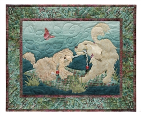Quilt block of two dogs playing tug-of-war over a rope toy, on a picnic blanket.