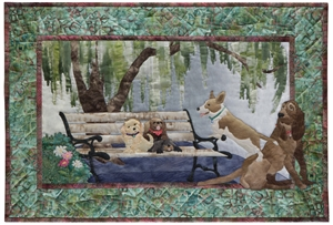 Quilt block of five dogs taking a time out on a park bench.