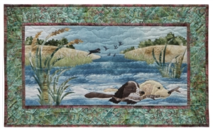Quilt block of two dogs carrying a stick as they swim through a stream together.