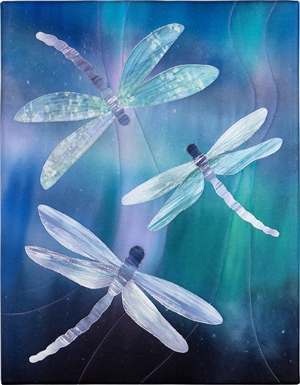 Three Dragonflies Dragonfly fluttering against a blue-green boreal background
