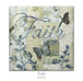 "Quilt block with the word ""Faith,"" stylized butterflies in ethereal floral patterns"
