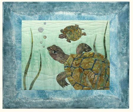 Quilt block of a pair of river turtles under water.