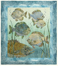 Quilt block of a school of fish in a river.