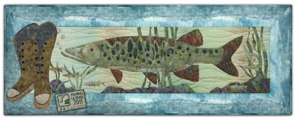 Quilt block of a pike at the bottom of a river, along with fishing boots and a fishing license.