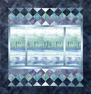 A peaceful view out of a picture window quilt, over water and to the forest