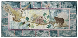 Quilt block of an owl landing on a branch next to her babies, startling a squirrel