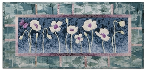 Quilt block of a field of poppy flowers