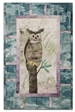 Quilt block of an owl sitting at the very top of a tree, watching the world