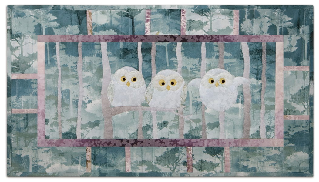 Quilt block of a trio of owlets trying out their wings for the first time