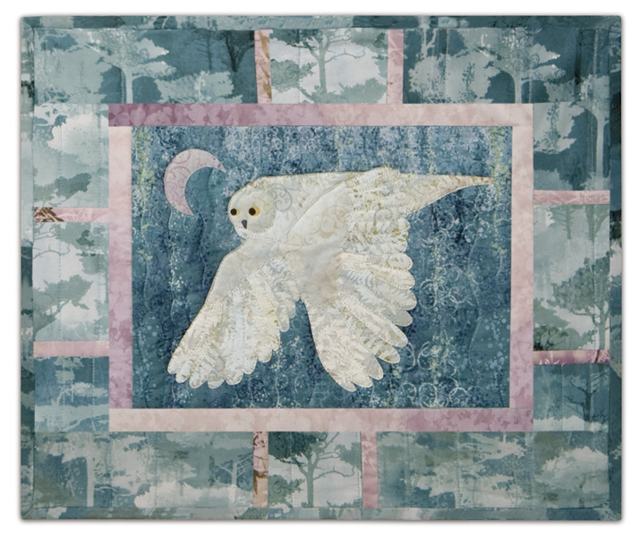 Quilt block of an owl on the hunt under the moon, inspired by the famous Rush song