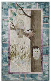 Quilt block of an owl dozing near her nest, while another owl peeks out of a hollow in the same tree