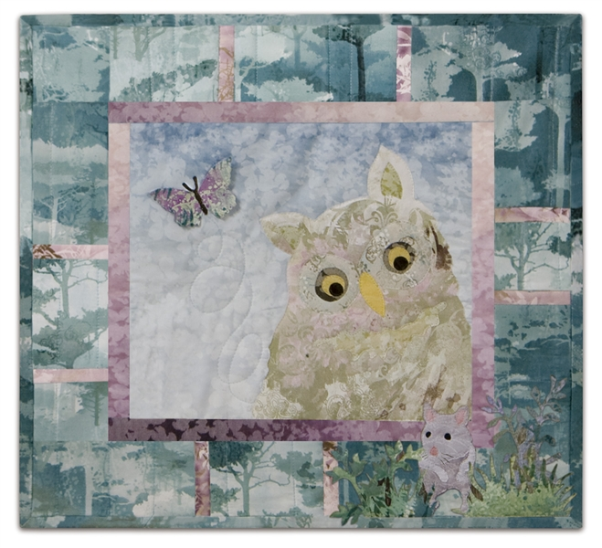 Quilt block of an owl claiming a mouse for lunch.