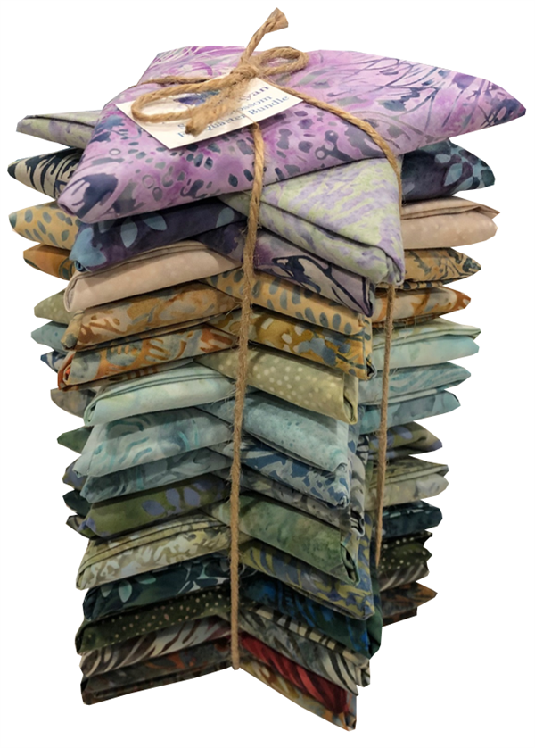 The complete set of 30 Seed to Blossom batiks, folded into fat quarters and bundled.