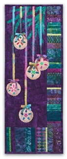 Quilt block of Christmas ornaments hanging off a tree by rainbow ribbon.