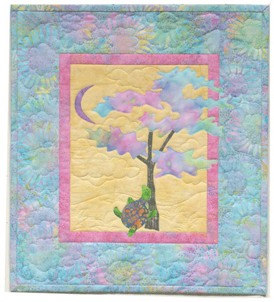 Quilt block of Turtle from block one taking a nap under a tree with the moon overhead
