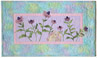 Quilt block of Bunny from block one taking a nap in a field of purple coneflower