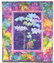 Quilt block of Turtle and Teddy from block one climbing a tree using teamwork