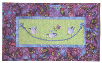 Quilt block of three blue birds swinging on a tight rope