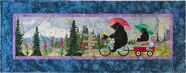 Mama bear riding her bike through the Portland country side with her babies in tow, one in the basket on the front of the bike and one on a wagon full of fabric in the back. Mount Hood, forest with flowers and city-scape in the background