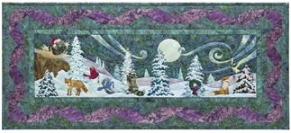 Quilt block of animals gathering by the light of moon to sing and celebrate the season.
