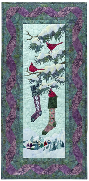 Quilt block of cardinals hanging stockings in a tree.