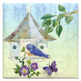 Quilt block of a fancy birdhouse in a nice neighborhood.