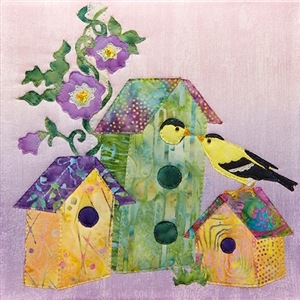 a fabric panel with a birdhouse and two finches