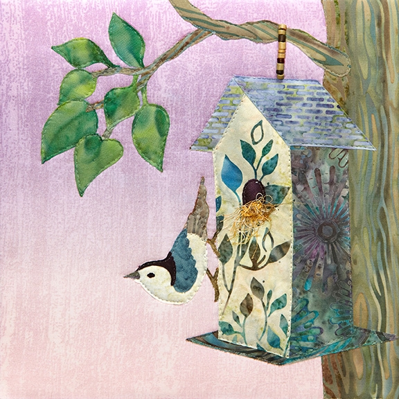 a fabric panel with a birdhouse