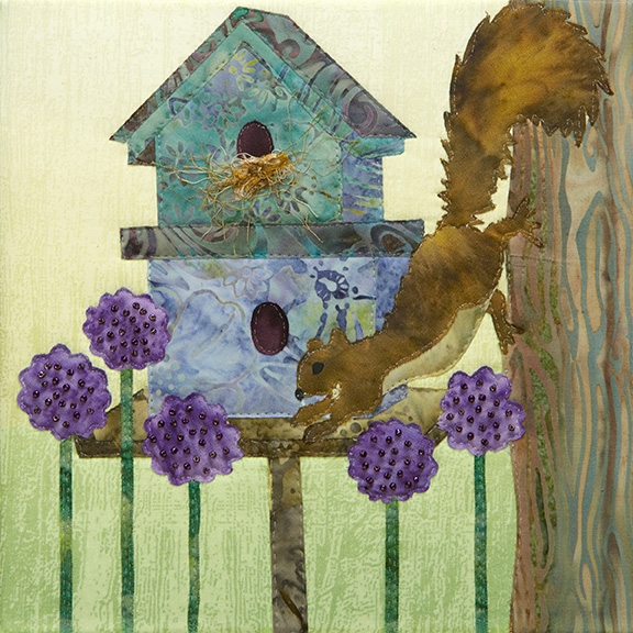 a fabric panel with a squirrel raiding a birdhouse