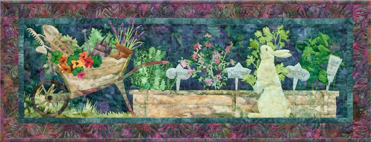 Quilt block of a rabbit named Stu tending to his garden, where he is growing rosemary, thyme, parsley, and basil, and his wheelbarrow piled high with his supplies and the flowers he's ready to plant.