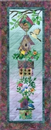Quilt block of six linked birdhouses, and a group of happy birds.