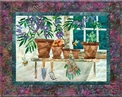 Quilt block of a potting bench with tools, and the bees attracted by the potted wisteria.