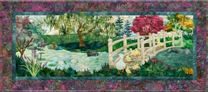 Quilt block of Mama Duck leading her family over the bridge to get to the pond.