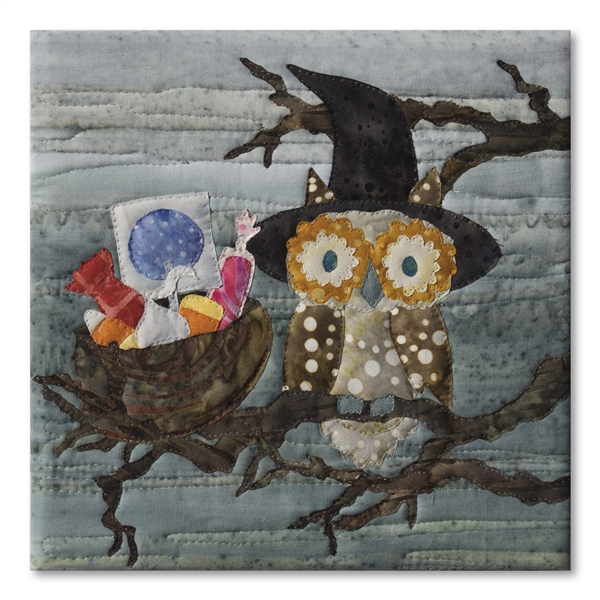 A wide-eyed owl has a nest full of candy. Laser Kit.