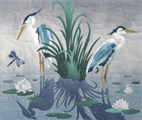 Two blue herons standing in a pond, surrounded by lily pads and a dragonfly. Laser Kit.