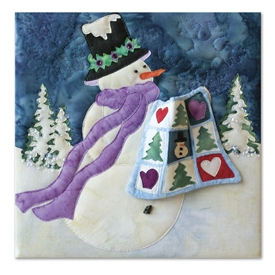 A snowman brings a quilt for show and tell. Laser Kit.