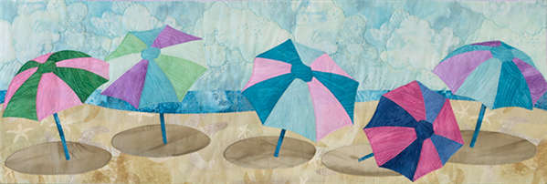 Quilt block of brightly-colored beach umbrellas.