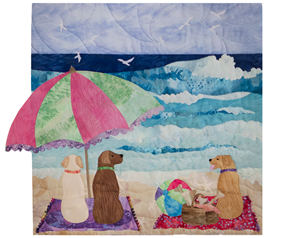 Three lucky dogs have a picnic on the beach.