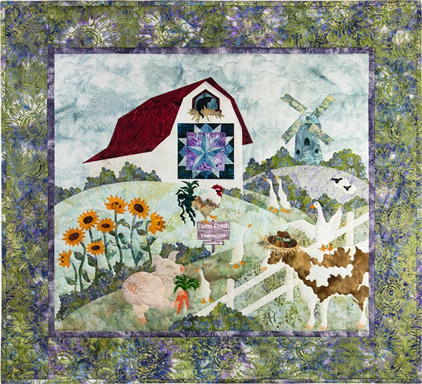a farm scene with a pig, geese, a cow, a rooster, a barn cat, and sheep. There is a windmill on the hillside, a field of sun flowers and a quilt on the barn wall.