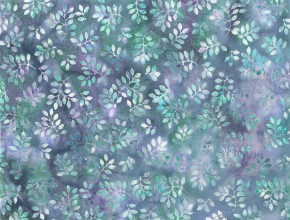 Batik fabric print of tiny leaves in shades of green and purple.