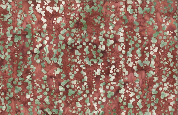 Batik fabric print of string of pearls in desert red adobe